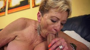 Nasty old granny is getting penetrated on the bed today